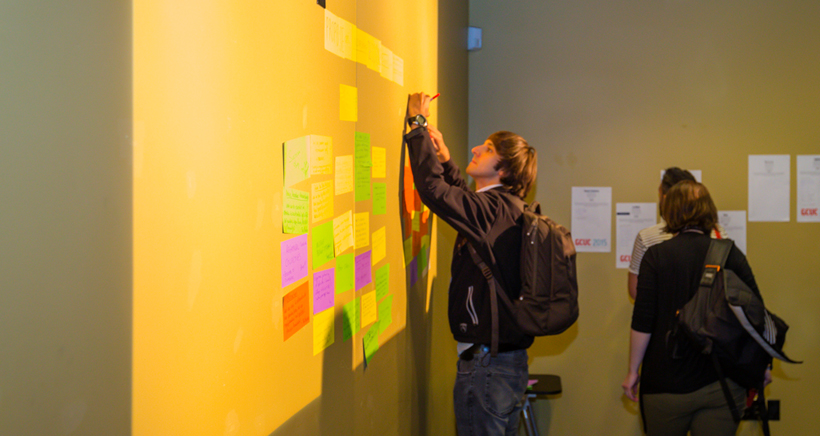 A GCUC 2015 attendee posts a topic on the wall.